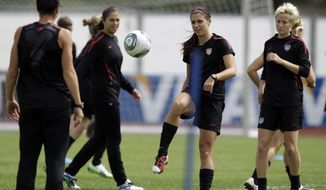 United States' Abby Wambach, Carli Lloyd, Alex Morgan and Megan Rapinoe go through drills during a practice in preparation for the World Cup final against Japan, which will take place Sunday. (AP Photo/Marcio Jose Sanchez)