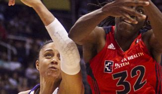 Phoenix Mercury forward Candice Dupree and Washington Mystics forward Kerri Gardin fight for a rebound during a WNBA basketball game on Friday in Phoenix. (AP Photo/The Arizona Republic, Pat Shannahan)
