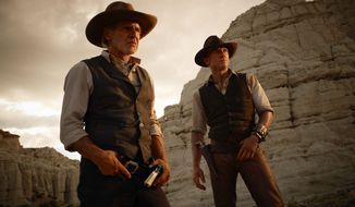 """Harrison Ford (left) and Daniel Craig in a scene from """"Cowboys & Aliens."""" (Associated Press)"""