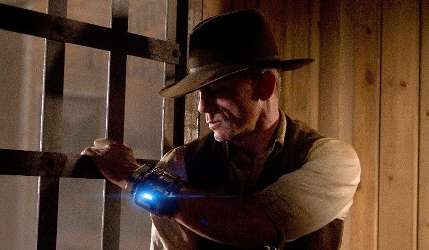 """Daniel Craig stars in director Jon Favreau's new film, """"Cowboys & Aliens,"""" which will have its world premiere this week at Comic-Con in San Diego. """"The right piece of material at that place, it will blast you into the stratosphere,"""" Mr. Favreau said. (Associated Press)"""