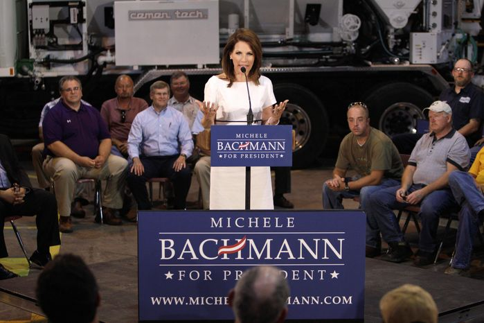 Republican presidential candidate Rep. Michele Bachmann of Minnesota speaks to employees and guests at the Cemen Tech plant in Indianola, Iowa, on July 11. She trails former Massachusetts Gov. Mitt Romney in fundraising from April to June by a wide margin. (Associated Press)