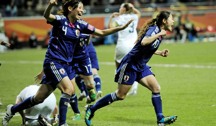 Homare Sawa (right) can't contain her glee after scoring Japan's second goal, and Saki Kumagai joins the celebration during the Women's World Cup final in Frankfurt, Germany. Japan won 3-1 on penalty kicks after the teams played to a 2-2 tie. (Associated Press)