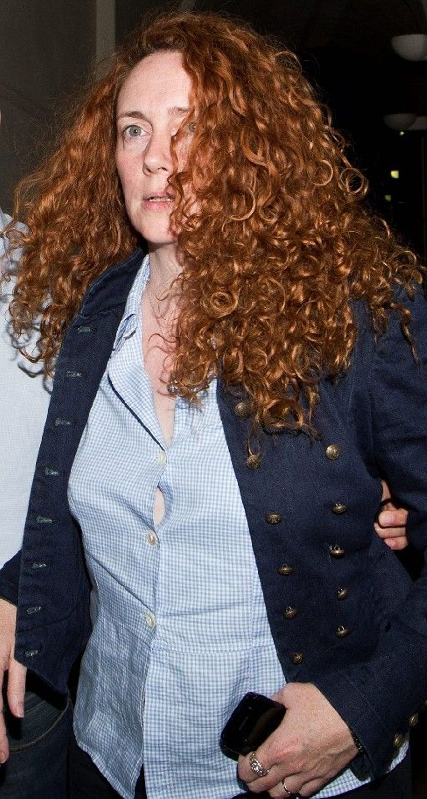 Rebekah Brooks, former British CEO of News Corp., was arrested in London and is being questioned about suspected phone hacking and corruption activities. (Associated Press)