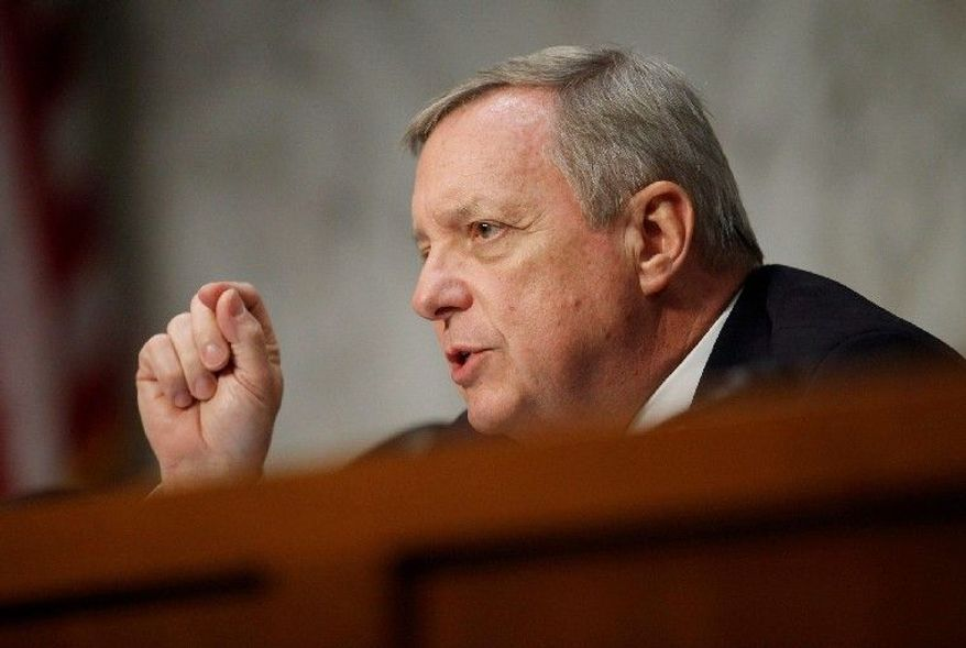 Sen. Richard J. Durbin, Illinois Democrat, says Congress should join an FBI investigation into whether News Corp. engaged in illegal activities in the United States.