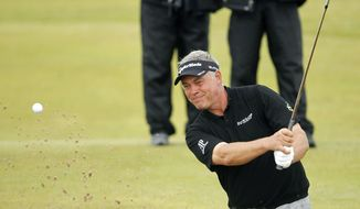 Northern Ireland's Darren Clarke hits a shot out of the bunker on the 11th hole during the final day of the British Open Golf Championship at Royal St. George's in Sandwich, England, on Sunday, July 17, 2011. (AP Photo/Peter Morrison)
