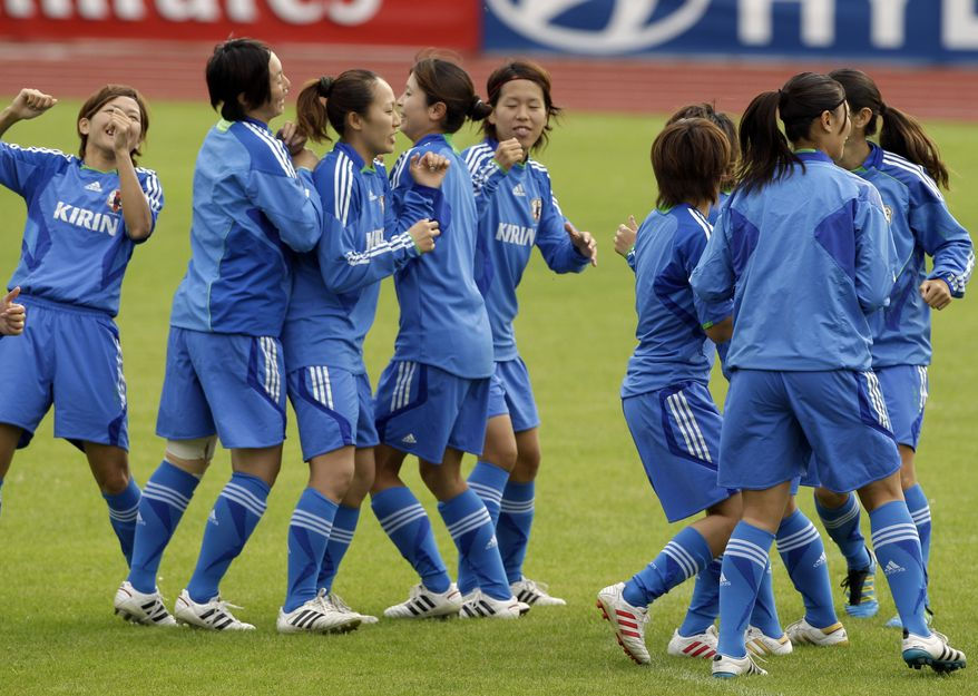 The Japanese women's soccer team warms up during practice on the eve of the final match between the United States and Japan for the Women's Soccer World Cup in Frankfurt, Germany, on Saturday, July 16, 2011. (AP Photo/Frank Augstein)