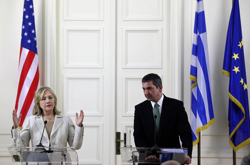 U.S. Secretary of State Hillary Rodham Clinton and Greek Foreign Minister Stavros Lambrinidis address the media at a joint news conference in Athens on Sunday, July 16, 2011. (AP Photo/Kostas Tsironis)