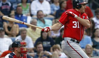 Washington Nationals' John Lannan recorded his first two hits of the season Saturday against the Atlanta Braves - driving in two runs on a second-inning single up the middle. The Nats won 5-2. (AP Photo/John Bazemore)