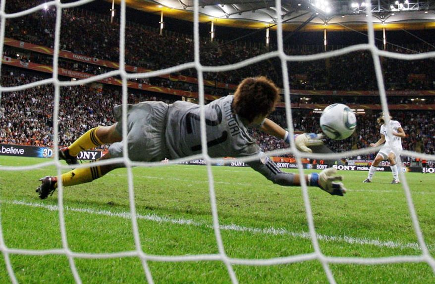 Goalkeeper Ayumi Kaihori of Japan saves a shot by Tobin Heath of the United States during a penalty shootout in the final match between Japan and the U.S. at the Women's Soccer World Cup. The Japanese team won its first world title on Sunday, July 17, 2011. (AP Photo/Frank Augstein)