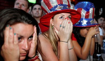 Jessica Doyle (center) and other fans react on Sunday, July 17, 2011, in Washington as the U.S. loses to Japan during the Women's World Cup soccer final in Germany. (AP Photo/Jacquelyn Martin)