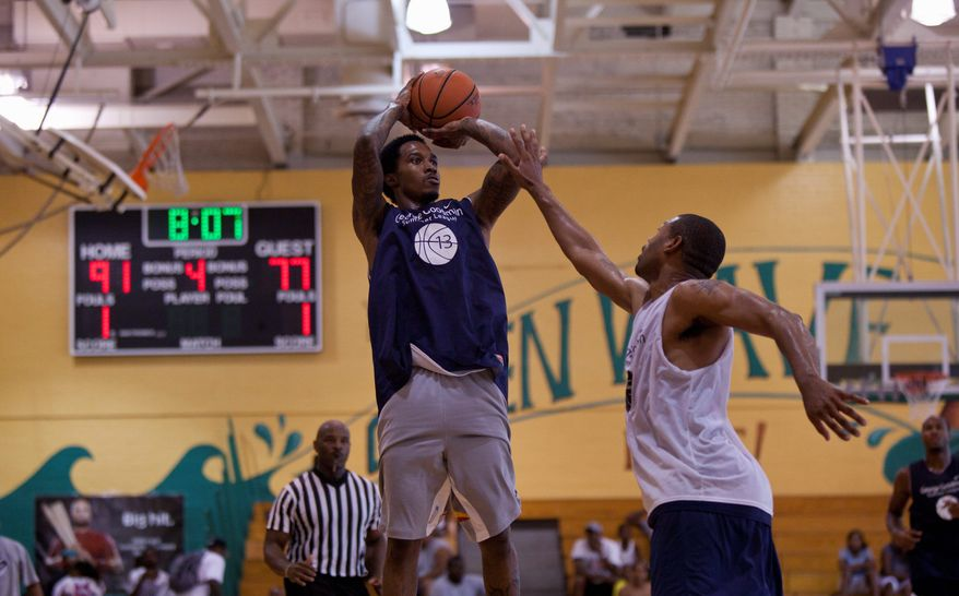 PRATIK SHAH/THE WASHINGTON TIMES Milwaukee Bucks point guard Brandon Jennings shoots during a game at Spingarn High School in Northeast D.C. Jennnings graduated from Oak Hill Academy in Mouth of Wilson, Va.