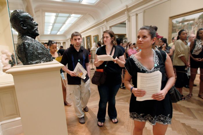 """ASSOCIATED PRESS Searching for clues as part in the """"Murder at the Met"""" scavenger hunt at the Metropolitan Museum of Art in New York this month are (from left) Matthew Meche, Dana Zolli and Noga Pnueli. Watson Adventures hosts hunts in 27 museums in seven U.S. cities."""