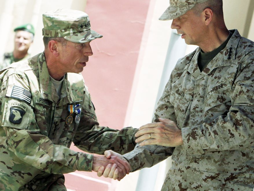 Gen. David H. Petraeus leaves command of U.S. and NATO-led forces in Afghanistan to Gen. John Allen during Monday's change-of-command ceremony in Kabul. Gen. Allen assumes responsibility for drawing up exit plans for U.S. and allied forces from the nearly 10-year war zone. (Associated Press)
