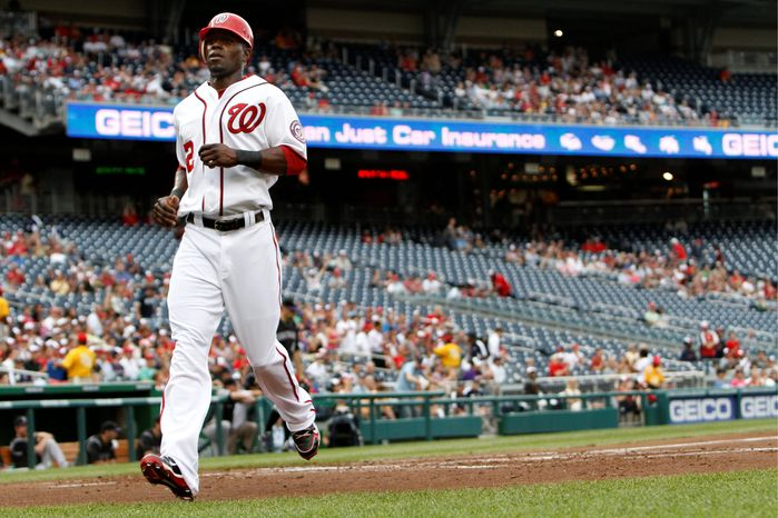 """""""He's still learning about himself as a hitter. ... But he definitely causes some problems when he gets on base,"""" manager Davey Johnson says of Roger Bernadina, shown scoring against Colorado on July 8. (Associated Press)"""