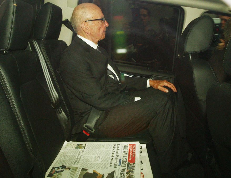 Media baron Rupert Murdoch leaves his London home on Monday, July 18, 2011. Mr. Murdoch and his son James are to be grilled by a parliamentary committee Tuesday over the phone hacking scandal. (AP Photo/Steve Parsons, Press Association)