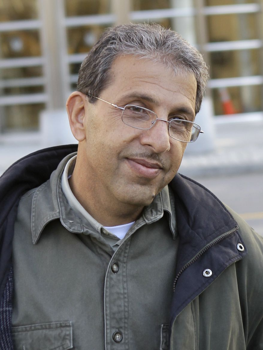 ** FILE ** Mohammed Wali Zazi leaves a federal courthouse in New York in December 2010. (AP Photo/Seth Wenig, File)