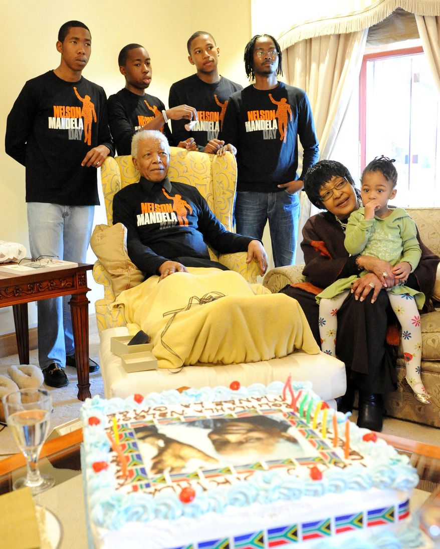 Former South African president Nelson Mandela (front left), his former wife Winnie Madikizela-Mandela (second from right) and other extended family members celebrate Mandela's 93rd birthday in his hometown of Qunu, South Africa, on July 18, 2011. (Associated Press/Peter Morey Photographic)