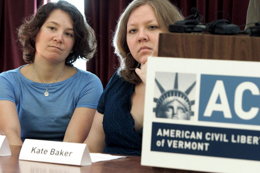 Ming Linsley (left) and Kate Baker discuss their discrimination lawsuit in Montpelier, Vt., on Tuesday. They say a Vermont resort refused to host their wedding reception because of the owners' personal views on homosexuals. (Associated Press)