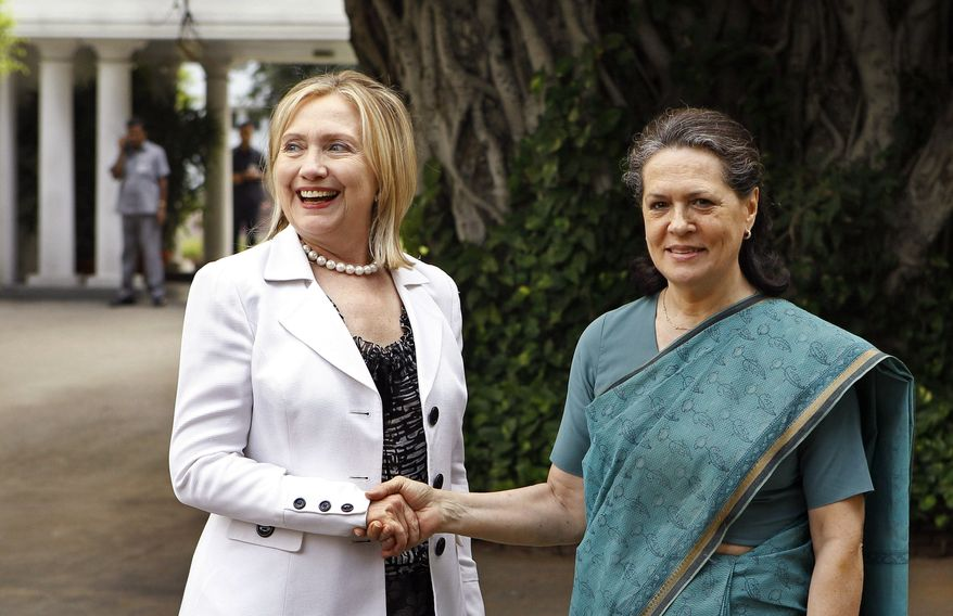 U.S. Secretary of State Hillary Rodham Clinton, left, shakes hands with India's Congress party President Sonia Gandhi before a meeting at Gandhi's residence in New Delhi, India, Tuesday, July 19, 2011. (AP Photo/Gurinder Osan)