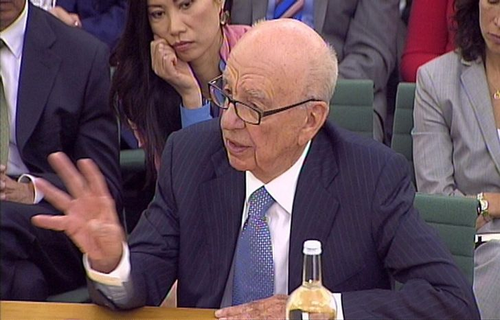 ** FILE ** Media baron Rupert Murdoch gives evidence before the British Parliament's Culture, Media and Sport Select Committee on the News of the World phone-hacking scandal in this image taken from TV on Tuesday, July 19, 2011, in London. (AP Photo/Press Association)