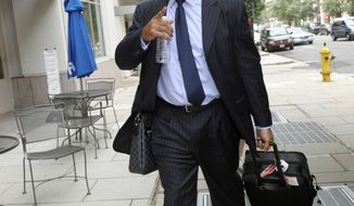 Retired NFL football player Cornelius Bennett arrives at the NFL Players Association offices in Washington on Tuesday as talks to end the NFL lockout contnue. (AP Photo/Susan Walsh)
