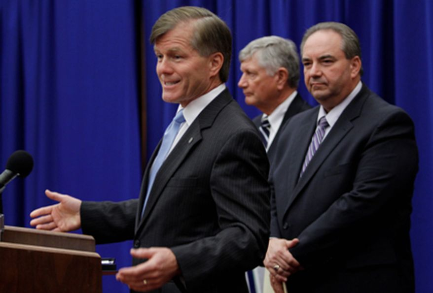 Virginia Gov. Bob McDonnell gestures as he announces a $311 million revenue surplus  for fiscal year 2011 during a news conference as Lt. Gov. Bill Bolling, right, and Secretary of Finance, Ric Brown, center, listen at the Capitol in  Richmond, Va., Tuesday, July 19, 2011.  (AP Photo/Steve Helber)