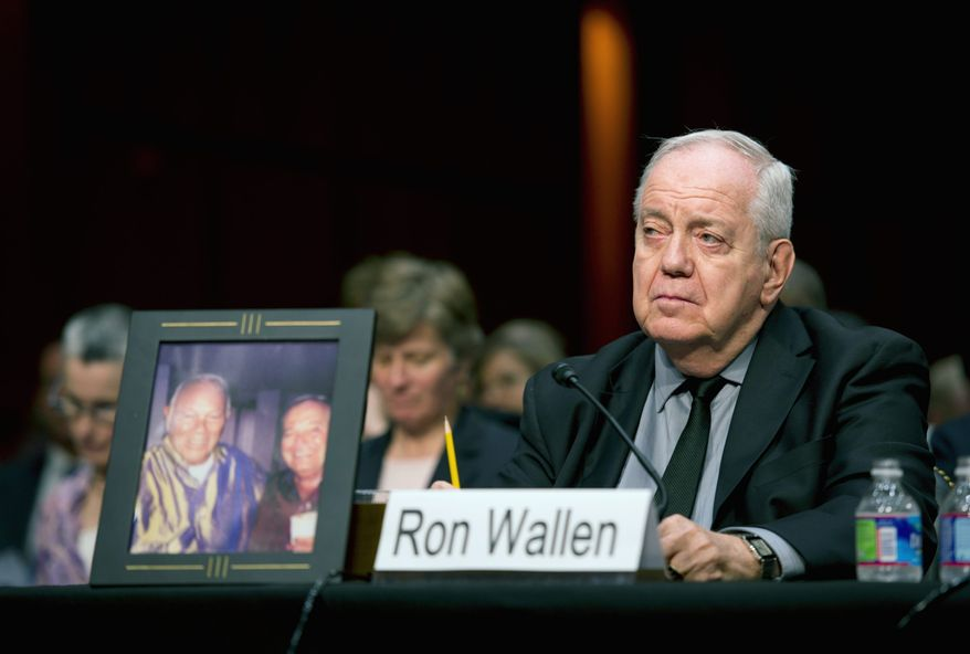 Photographs by Barbara L. Salisbury/The Washington Times Ronald Wallen, of Indio, Calif., displays a photo of his deceased partner at a Senate Judiciary Committee hearing Wednesday. Mr. Wallen testified that he was denied federal benefits after his partner's death because of the Defense of Marriage Act.