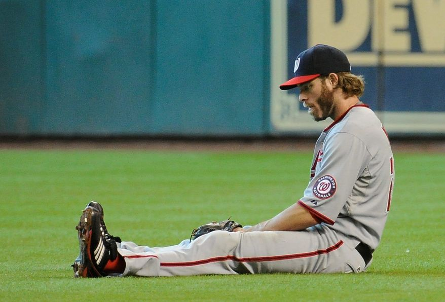 ASSOCIATED PRESS Nationals right fielder Jayson Werth sits dejectedly after being unable to catch a ball from Humberto Quintero, who subsequently scored the winning run.