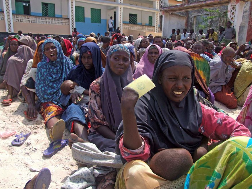Somali women displaced by drought wait to receive rations at a camp in Mogadishu, Somalia, on July 20. Southern parts of Somalia are experiencing famine, a U.N. official said Wednesday, and tens of thousands of Somalis have already died in the worst hunger emergency in a generation. (Associated Press)