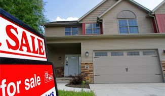An existing home is on the market in Springfield, Ill., on Thursday, July 14, 2011. Fewer people bought previously occupied homes in June, a grim sign that the worst of the housing crisis might not be over. (AP Photo/Seth Perlman)