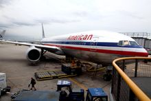 An American Airlines plane is parked at the terminal at O'Hare International airport in Chicago on July 20, 2011. (Associated Press)