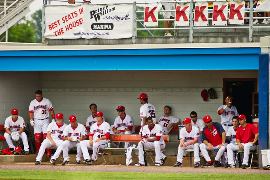 The Potomac Nationals watch from their small-sized dugout during a game against the Lynchburg Hillcats in 2011. (The Washington Times)