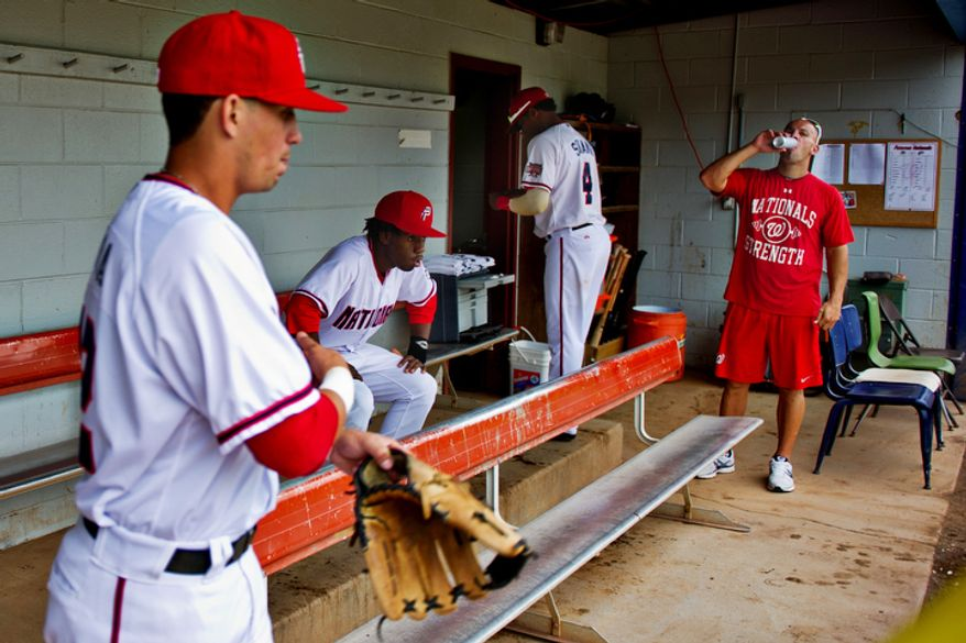 Potomac Nationals players mill about in the small dugout at Pfitzner Stadium, prior to taking the field for a game against the Lynchburg Hillcats, in Woodbridge, Va., Tuesday, July 19, 2011.  (Drew Angerer/The Washington Times)