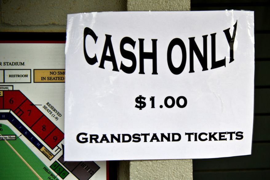 A cash only sign is taped to the ticket booth at Pfitzner Stadium, during a game between the Potomac Nationals and Lynchburg Hillcats, in Woodbridge, Va., Tuesday, July 19, 2011. (Drew Angerer/The Washington Times)