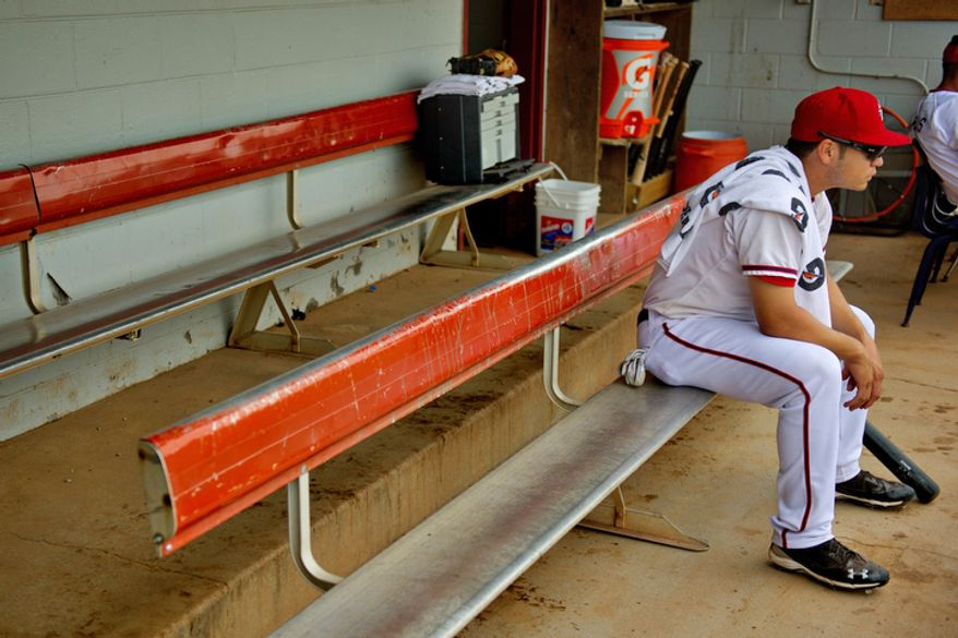 Potomac Nationals outfielder J.P. Ramirez sits in the small dugout at Pfitzner Stadium, prior to a game between the Potomac Nationals and Lynchburg Hillcats, in Woodbridge, Va., Tuesday, July 19, 2011.  (Drew Angerer/The Washington Times)