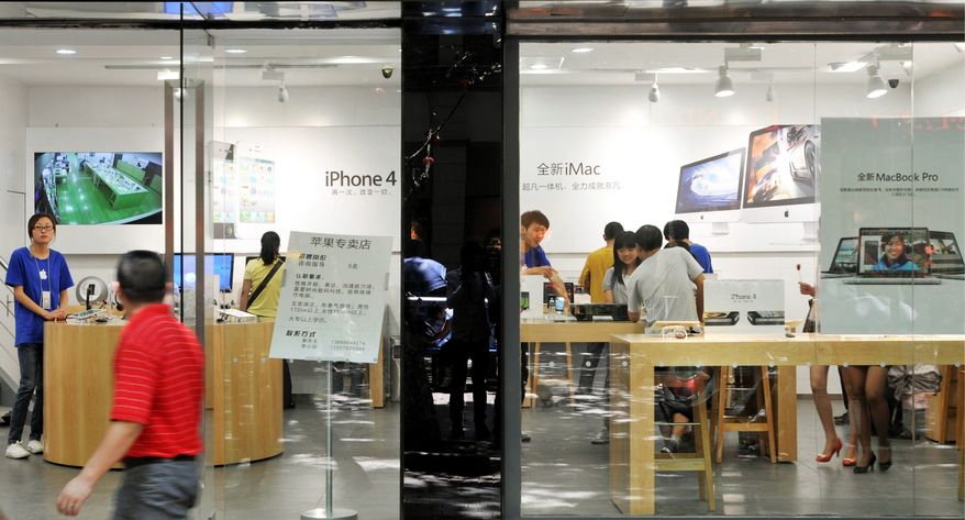 ASSOCIATED PRESS This fake Apple store is one three such locations in Kunming, China. The 27-year-old blogger who exposed the fakes said the stores were so convincing that the employees seemed to think they worked for Apple.
