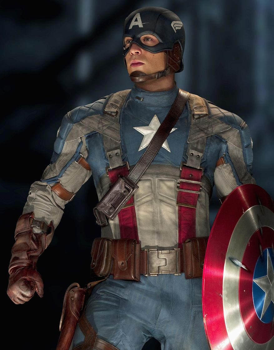 """Chris Evans is not much of an actor, but he doesn't have to be. The title role in """"Captain America: The First Avenger"""" demands little more than a prominent display of ab muscles - and he's as perfectly sculpted a male physical specimen as you're likely to find. (Paramount Pictures photograph)"""