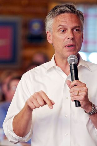 Jon Huntsman Jr., a candidate for the Republican presidential nomination, speaks to a group of Spartanburg and Greenville County Republicans gathered at Mutt's BBQ in Spartanburg, S.C., on Monday. (Associated Press)