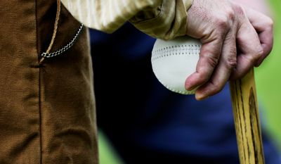 Umpire Richard D'Ambrisi holds the game ball during the Loudoun Preservation Society's 19th Century Baseball Day at the Oatlands, in Leesburg, Va., Sunday, June 12, 2011. There are a few interesting facts about the 1860s era ball that was used. First, it is made of mostly leather and is much softer than modern baseballs.  (Drew Angerer/The Washington Times)