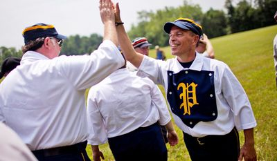 """Potomac Nine pitcher J.D. """"Buckeye"""" Almond, of Marshall, Va., gives a high five to Gene """"Pop"""" Meacham, of Bowie, after their 5-4 win over the Elkton Eclipse during the Loudoun Preservation Society's 19th Century Baseball Day at the Oatlands, in Leesburg, Va., Sunday, June 12, 2011. Almond said this is his fourth year playing in the league. (Drew Angerer/The Washington Times)"""