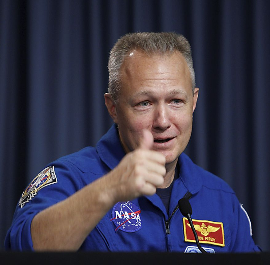 STS-135 shuttle pilot Doug Hurley gives a thumbs up during the post-landing news conference at the Kennedy Space Center at Cape Canaveral, Fla., on Thursday, July 21, 2011. The landing of the space shuttle Atlantis marks the end of NASA's 30-year shuttle program. (AP Photo/J. Pat Carter)
