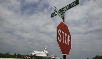 Space shuttle Atlantis is towed to the Orbitor Processing Facility for decommissioning at the Kennedy Space Center at Cape Canaveral, Fla., on Thursday, July 21, 2011. The landing of the spacecraft marks the end of NASA's 30-year shuttle program. (AP Photo/John Raoux)
