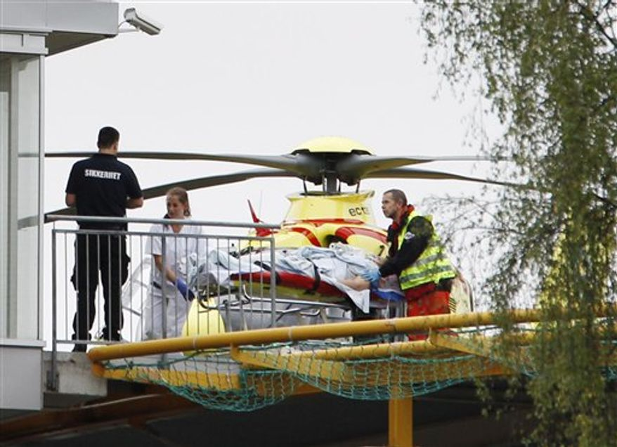 A person injured at the youth camp on the island of Utoya is taken from a helicopter into the Ullevaal Hospital in Oslo Friday July 22, 2011. At Utoya, an island outside Oslo, a gunman dressed in a police uniform opened fire at a Labor Party youth camp, shooting several youths, party spokesman Per Gunnar Dahl told The Associated Press. (AP Photo/Scanpix, Hakon Mosvold Larsen)