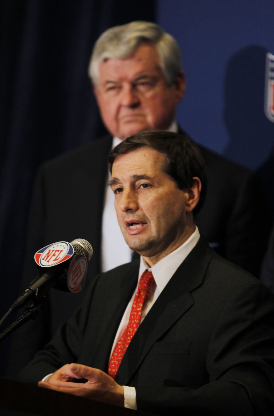 NFL football lead counsel Jeff Pash, foreground, speaks as Carolina Panthers owner Jerry Richardson looks on after it was announced that NFL owners have agreed to a tentative agreement that would end the lockout pending the players approval in College Park, Ga., on Thursday. Players have yet to vote on the approved 10-year collective bargaining agreement. (AP Photo/John Bazemore)
