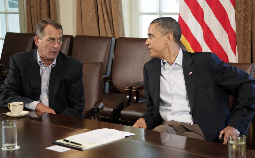 President Barack Obama meets with House Speaker John Boehner of Ohio, left, in the Cabinet Room of the White House, Saturday, July 23, 2011, in Washington, to discuss the debt. (AP Photo/Carolyn Kaster)