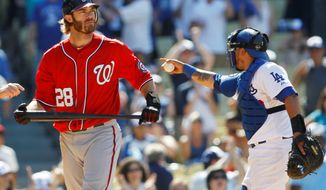 associated press Washington Nationals' Jayson Werth, left, reacts after striking out for the last out as Los Angeles Dodgers catcher Dioner Navarro, right, celebrates during the ninth inning of a baseball game, Sunday, July 24, 2011, in Los Angeles. (AP Photo/Danny Moloshok)