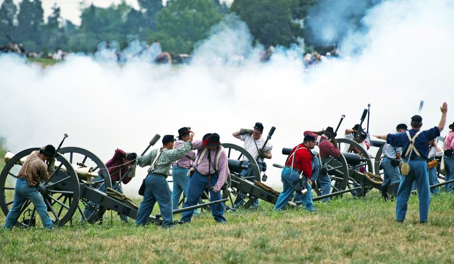 PHOTOGRAPHS BY DREW ANGERER / THE WASHINGTON TIMES Union artillery units fire their cannons toward the Confederates during Sunday's 150th anniversary re-enactment of the Battle of First Manassas/Bull Run at Pageland Farm in Gainesville, Va. It was the first major land battle between the North and South in the Civil War.