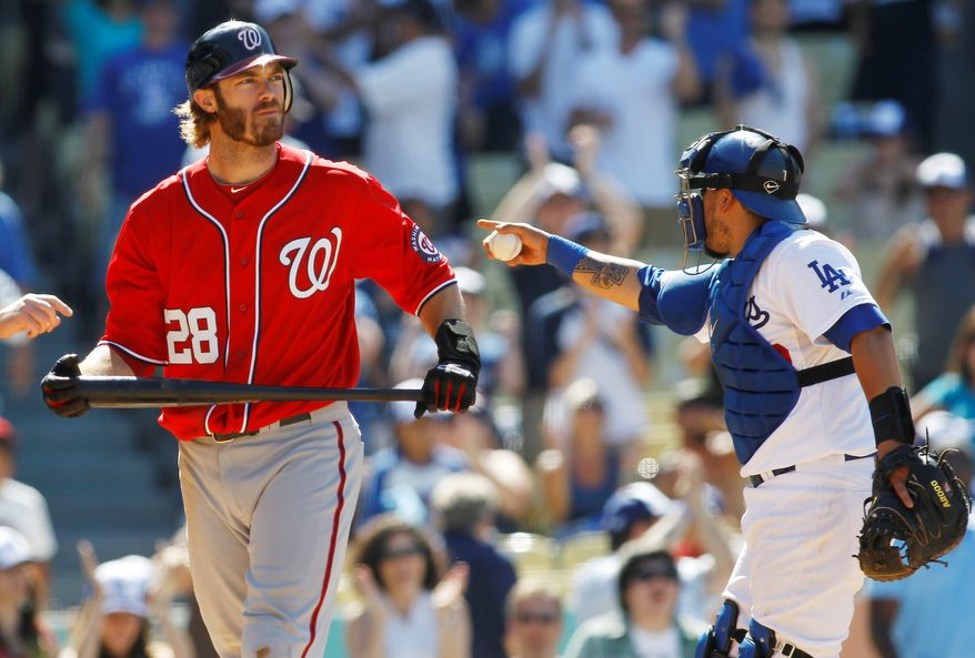 Nationals right fielder Jayson Werth (left) reacts after striking out to end the game as Dodgers catcher Dioner Navarro celebrates. Chad Billingsley (below) allowed two hits, struck out 10 and walked two in seven innings, leading Los Angeles to a 3-1 win in the rubber match of the three-game series. (Associated Press)