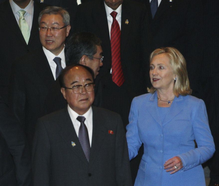 South Korean Foreign Minister Kim Sung-hwan, top left, walks by his North Korean counterpart Pak Ui Chun, bottom center, as U.S. Secretary of State Hillary Rodham Clinton talks with Japanese Foreign Minister Takeaki Matsumoto, center, prior to the start of ARF Retreat Session in Nusa Dua, Bali, Indonesia, Saturday, July 23, 2011. (AP Photo/Dita Alangkara)