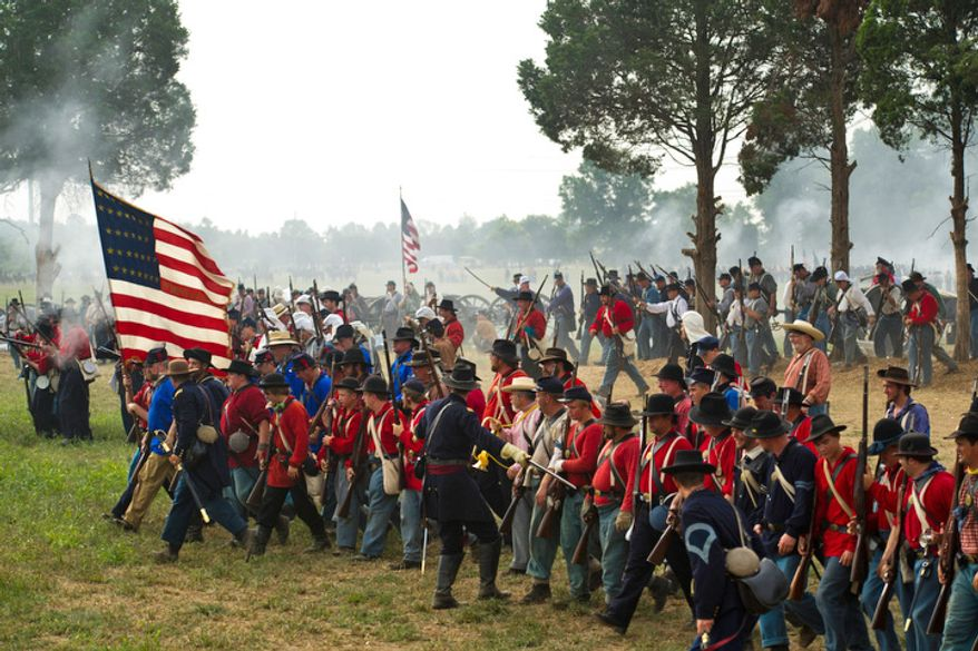 Union troops move down the battlefield during the 150th Anniversary of the Battle of First Manassas/Bull Run Reenactment .(Drew Angerer/The Washington Times)